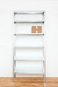 Cardboard box on steel shelf