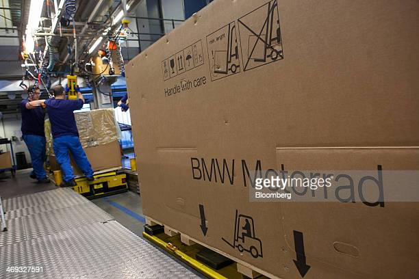 A cardboard box sits on a pallet as employees package a motorbike for shipping at the Bayerische Motoren Werke AG factory in Berlin Germany on...