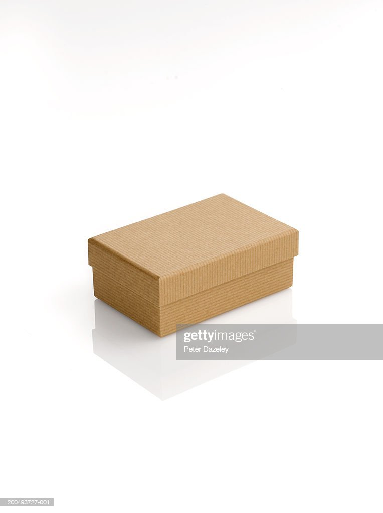 Cardboard box with lid, against white background, close-up