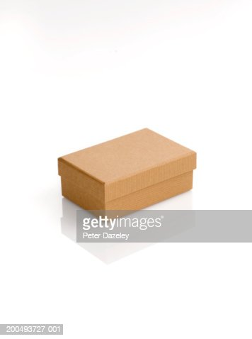 Cardboard box with lid, against white background, close-up : Stock Photo
