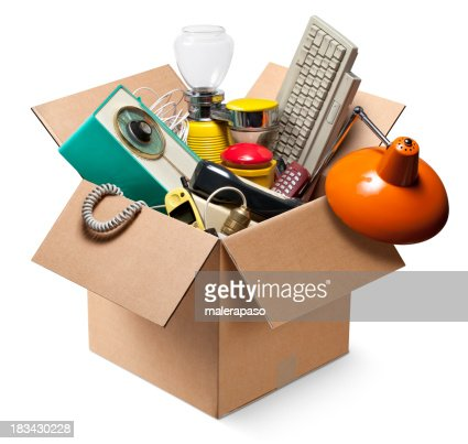 Cardboard box with old electrical appliances