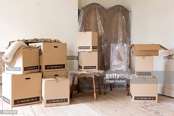 Cardboard boxes and furniture in room