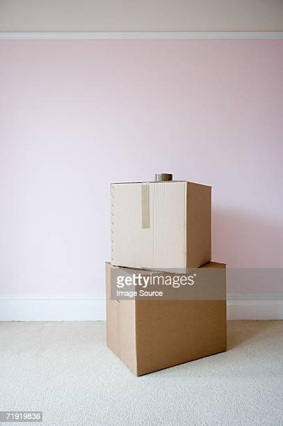 Cardboard boxes in sparse room