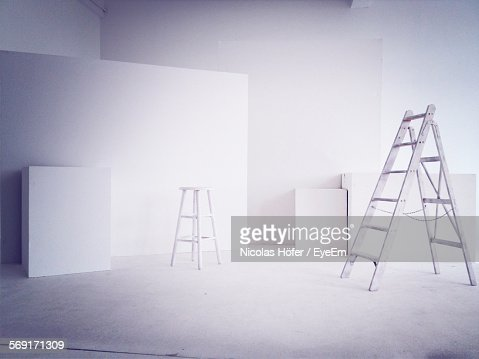 Cardboard Boxes In White Room