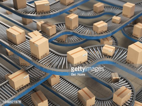 Cardboard boxes on conveyor roller in distribution warehouse, Delivery and packaging service concept background. : Stock Photo