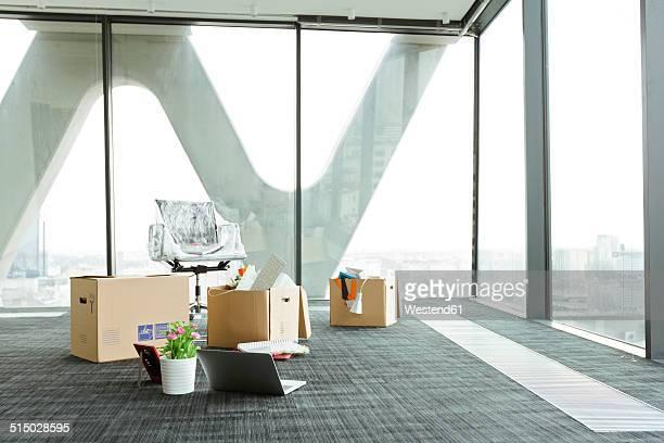 Cardboard boxes on empty office floor