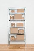 Cardboard boxes on steel shelf