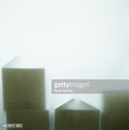 Cardboard boxes seen through frosted glass : Stock Photo