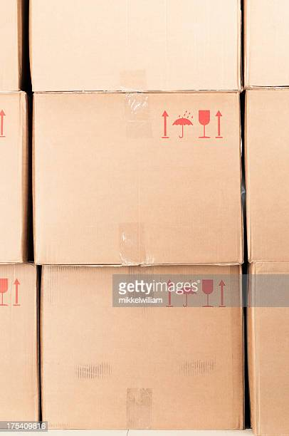 Cardboard boxes stacked in storage room