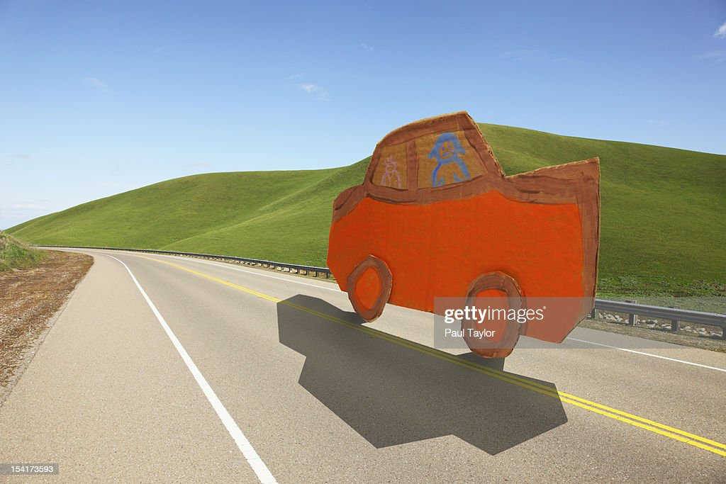 Cardboard Car on Road : Stock Photo