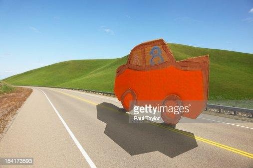 Cardboard Car on Road : Stock Photo