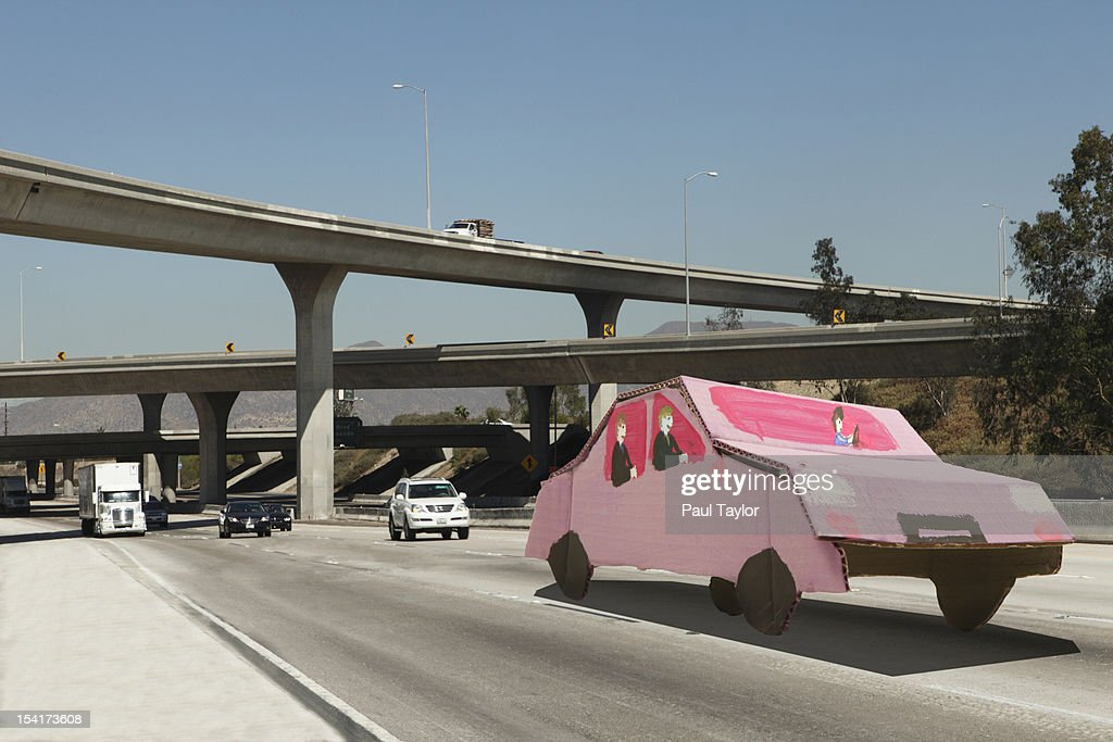 Cardboard Carpool Car on Freeway : Stock Photo