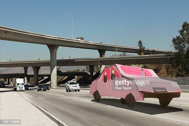 Cardboard Carpool Car on Freeway