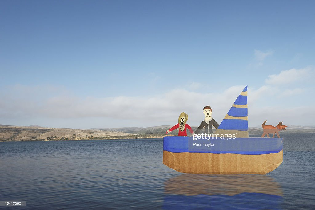 Cardboard Couple in Boat : Stock Photo