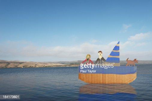 Cardboard Couple in Boat : Stock Photo