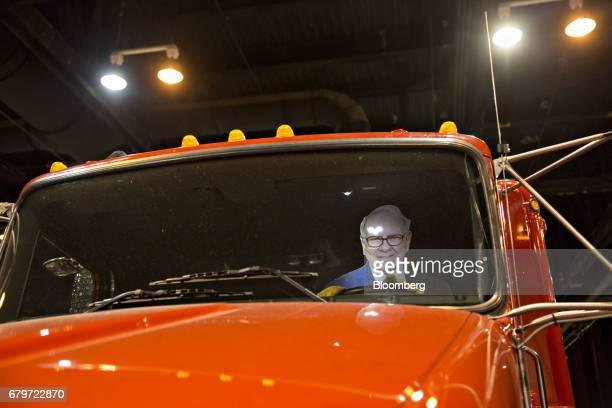 A cardboard cut out in the likeness of Warren Buffett chairman and chief executive officer of Berkshire Hathaway Inc sits in the driver's seat of a...
