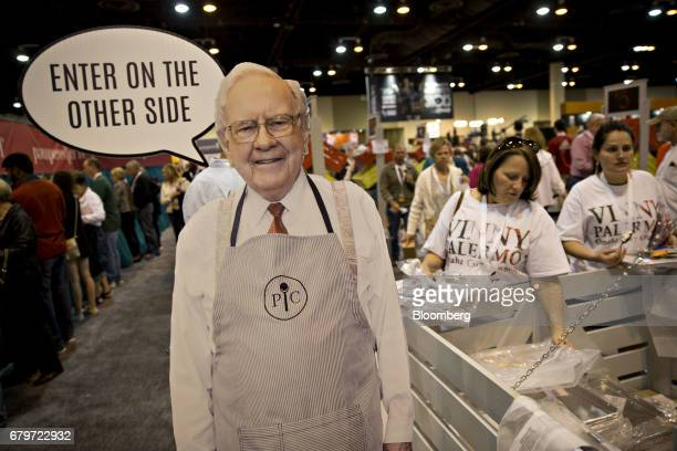 A cardboard cut out in the likeness of Warren Buffett chairman and chief executive officer of Berkshire Hathaway Inc stands at the exit of the...