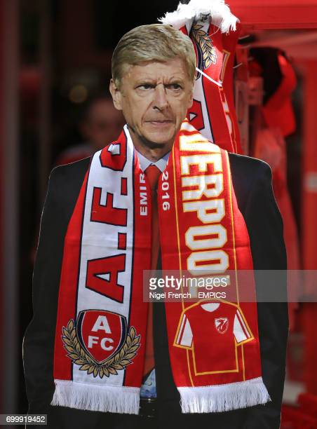 A cardboard cut out of Arsenal manager Arsene Wenger wearing a half and half scarf before the game against Liverpool
