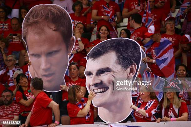 Cardboard cut outs of Jamie Murray and Dominic Inglot are held by Great Britain fans ahead of their doubles match against Julien Benneteau and...