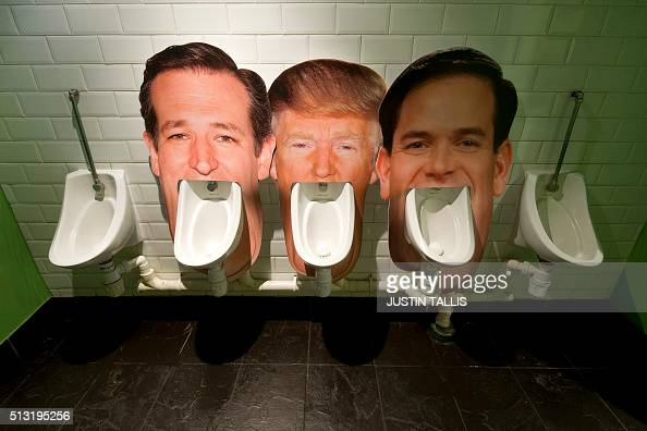 Cardboard cut outs of the faces of three candidates for the Republican nomination for the 2016 US Presidential election Ted Cruz Donald Trump and...