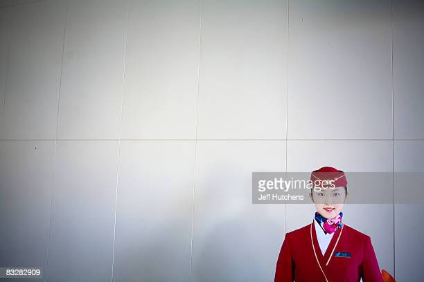 A cardboard cutout of a Chinese flight attendant sits in the Hetian airport on October 21 2007 in Xinjiang China