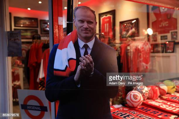 A cardboard cutout of former Arsenal player Dennis Bergkamp for sale before the Premier League match at the Emirates Stadium London