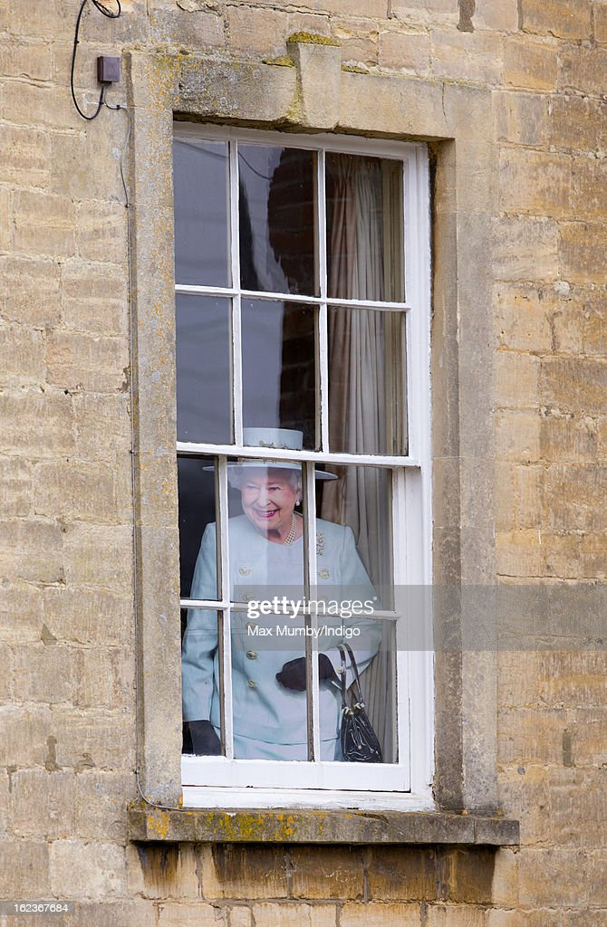 A cardboard cut-out of Queen Elizabeth II seen in the window of a house overlooking the Uley Community Stores and Post Office prior to a visit by Prince Charles, Prince of Wales on February 22, 2013 in Uley, Gloucestershire, England.