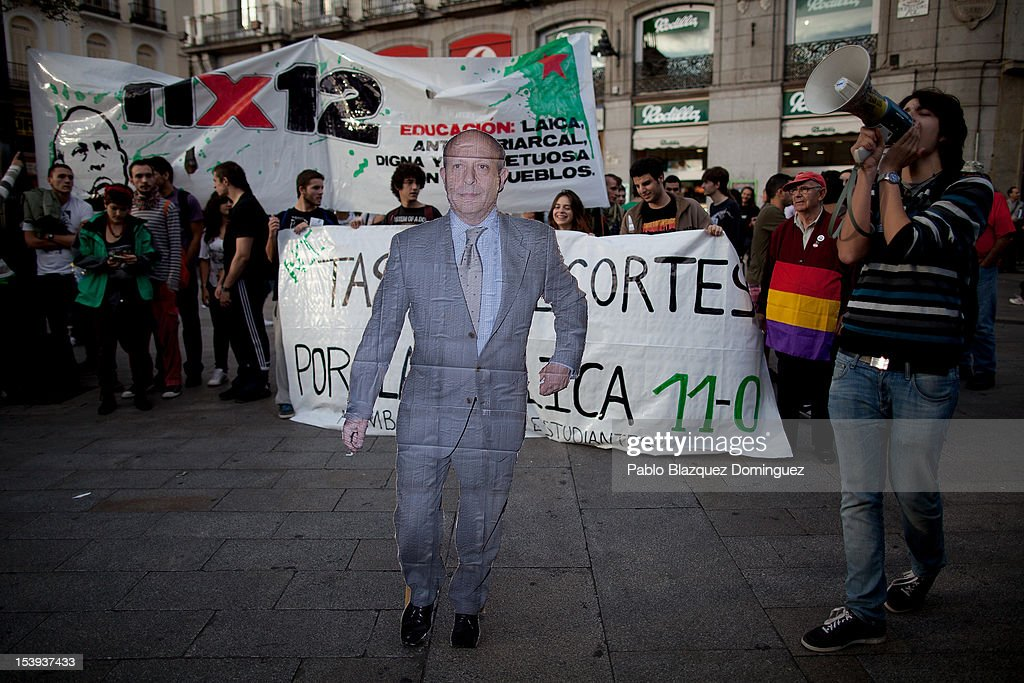 A cardboard cutout of Spain's Minister of Education Jose Ignacio Wert Ortega stands during a demonstration by students protesting against education cuts at Puerta del Sol on October 11, 2012 in Madrid, Spain. Ratings agency Standard & Poor's has cut Spain's credit rating down to BBB-. The Spanish government has already introduced spending cuts and tax increses in an attempt to ease the country's debt and reduce high unemployment levels. Spain's Minister of Economy Minister Luis de Guindos maintains that the country will not need to request a bailout.