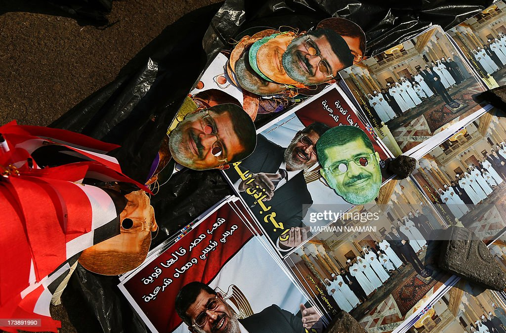Cardboard cutouts of Egypt's ousted president Mohamed Morsi are displayed for sale outside Rabaa al-Adawiya mosque in Cairo on July 18, 2013. Morsi's overthrow has deeply divided Egypt, between those who back the army's decision to topple the country's first democratically elected president on July 3 after massive nationwide protests, and his supporters who say the move was an affront to democracy.