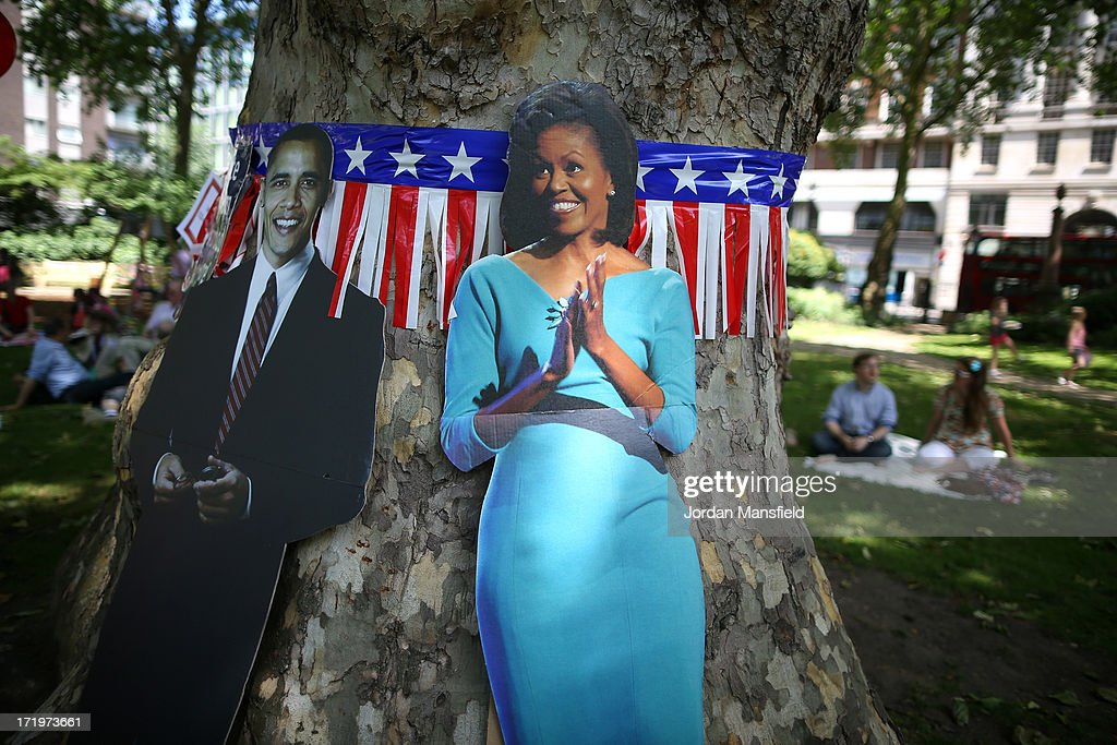 Cardboard cutouts of Michelle and Barack Obama lean by a tree on June 30, 2013 in London, England. American Democrats living in London gather in Portman Square for the largest Independence Day celebration in London ahead of the American federal holiday on the 4th July which commemorates the Declaration of Independence on July 4, 1776 which declared them the USA free from the Kingdom of Great Britain.