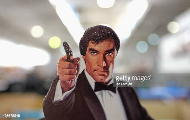 A cardboard figure of actor Timothy Dalton is displayed during a James Bond memorabilia auction on November 25 2015 in StocktononTees England Around...