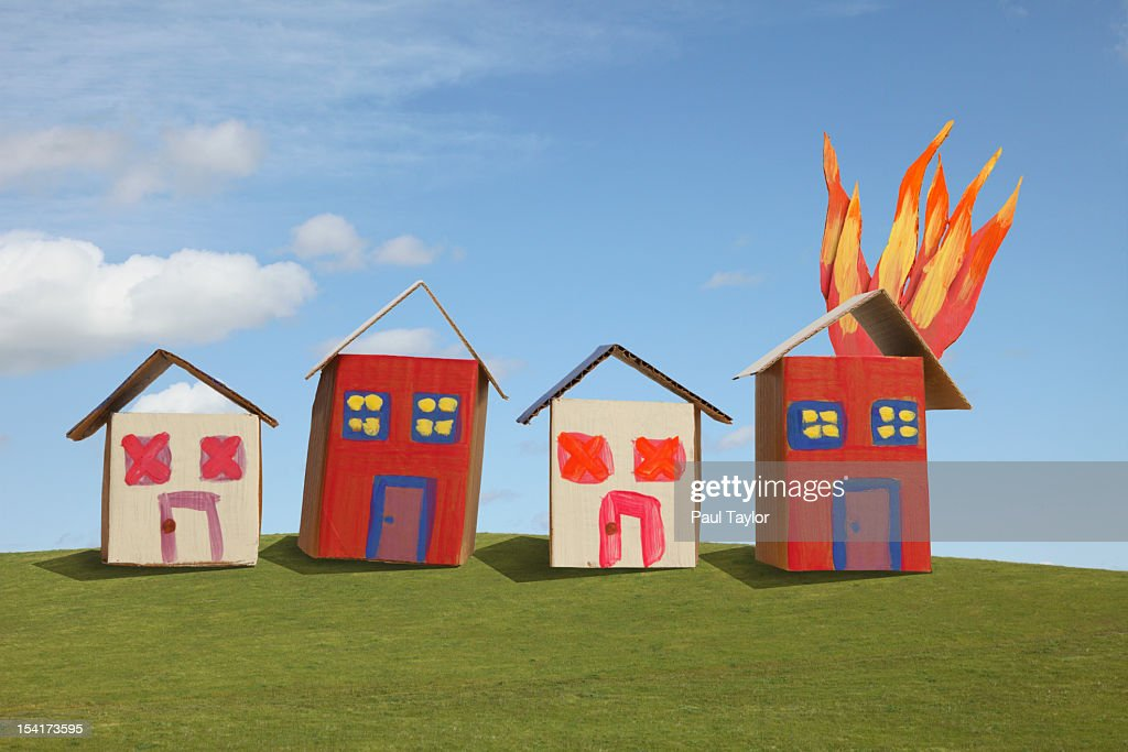 Cardboard Houses, One on Fire : Stock Photo