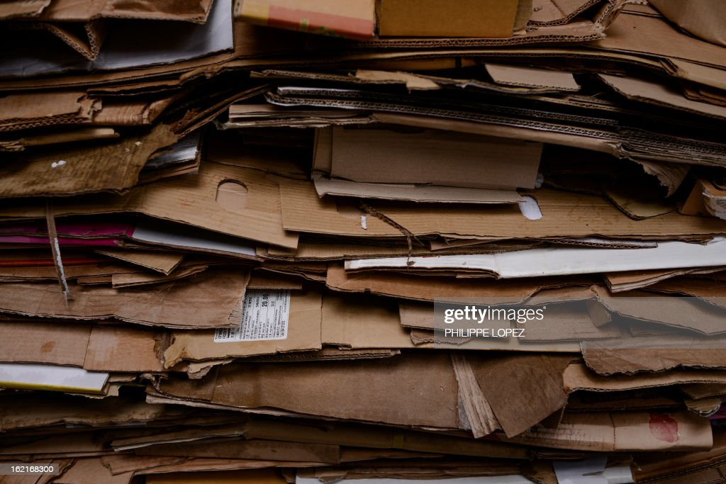 Cardboard is piled up before being recycled in Hong Kong on February 20, 2013. Activists have claimed for years that Hong Kong lags behind the rest of the world on environmental issues ranging from recycling to lanes for cyclists. AFP PHOTO / Philippe Lopez