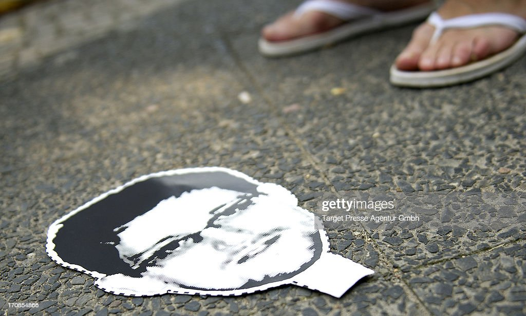 A cardboard mask depicting Edward Snowden lies on the ground at a protest against the PRISM electronic surveillance program which was leaked by...