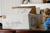 Cardboard moving box labeled ''tres fragile''
