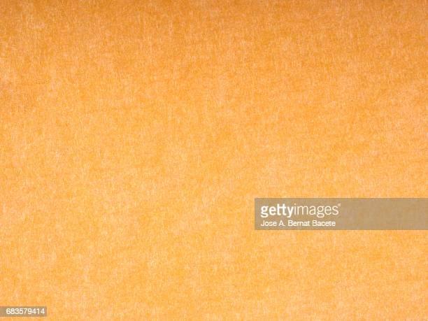 Cardboard or paper antique texture background light orange color
