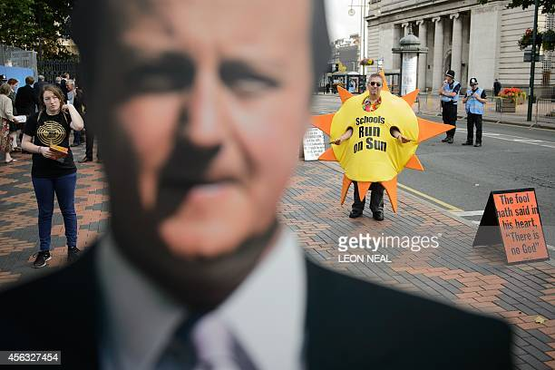 A cardboard standee of British Prime Minister David Cameron is seen among fringe campaigners on day two of the Conservative Party conference in...
