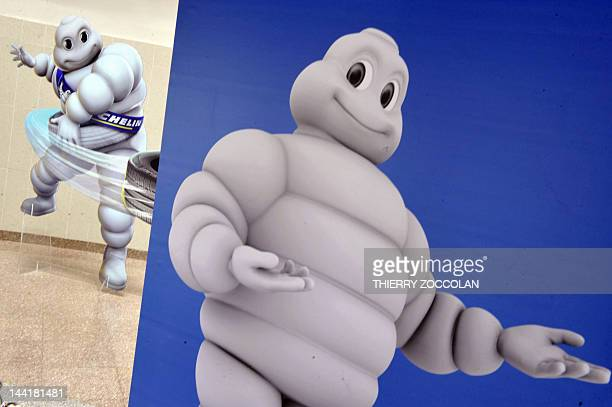 Cardboards logo of Michelin are displayed at the entrance of the headquarters of the French tyre group Michelin in ClermontFerrand centre France on...