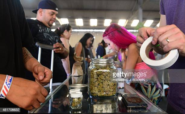 Cardcarrying medical marijuana patients attend Los Angeles' firstever cannabis farmer's market at the West Coast Collective medical marijuana...