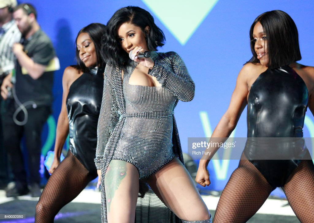 Cardi B (C) performs during the 2017 MTV Video Music Awards at The Forum on August 27, 2017 in Inglewood, California.