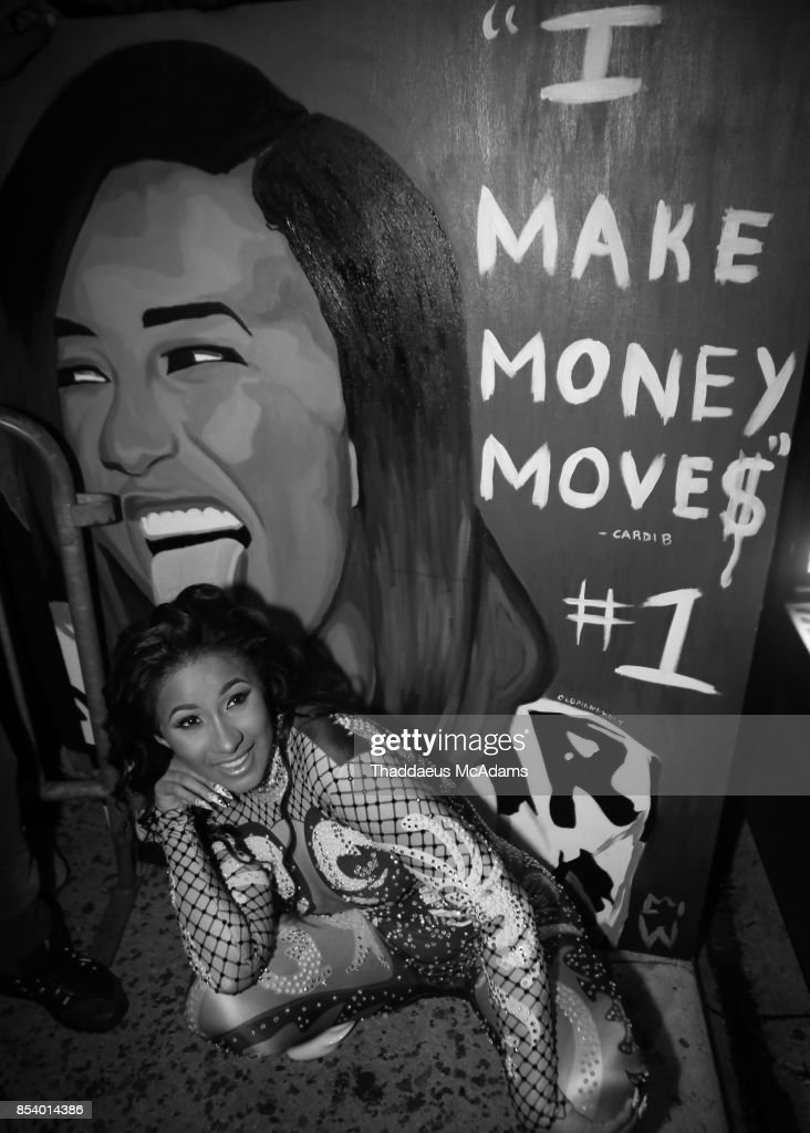 Cardi B poses with a fan made painting while leavinig Revolution Live on September 25, 2017 in Fort Lauderdale, Florida.