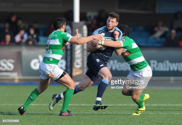 Cardiff Blues' Alex Cuthbert is tackled by is tackled by Benetton Treviso's Ian McKinley and Tito Tebaldi during the Guinness Pro12 Round 15 match...