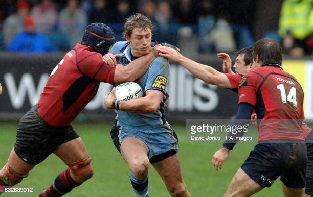 Cardiff Blues' Jamie Robinson is caught by Munster's Alan Quinlan Tomas O'Leary and Ian Dowling during the Heineken Cup match at Cardiff Arms Park...