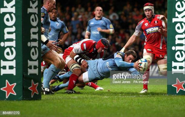 Cardiff Blues' Nick Robinson crosses for a try under the posts against Gloucester during the Heineken Cup match at the Millennium Stadium Cardiff