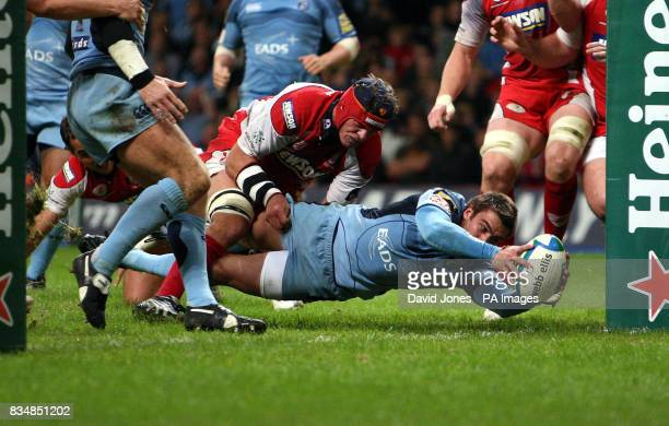 Cardiff Blues' Nicky Robinson crosses for a try under the posts against Gloucester during the Heineken Cup match at the Millennium Stadium Cardiff
