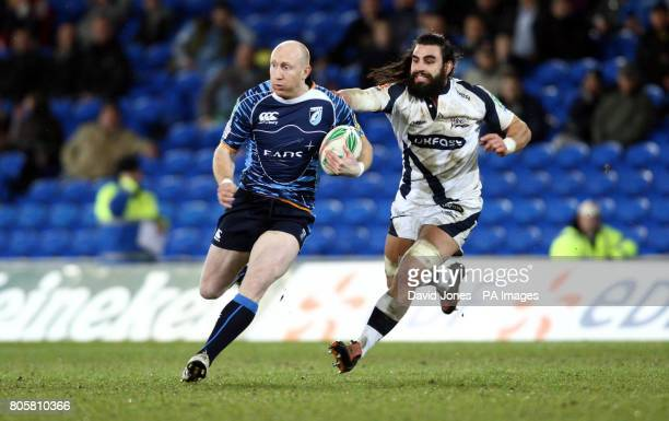 Cardiff Blues' Tom Shanklin is chased by Sale Sharks' Luke Abraham during the Heineken Cup match at Cardiff City Stadium Cardiff