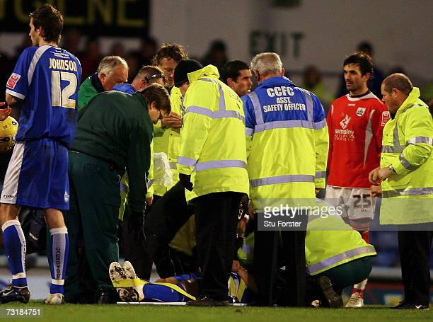 Cardiff City defender Kevin Mcnaughton recieves treatment after a serious injury meant that he had to be strechered off the pitch during the Coca...
