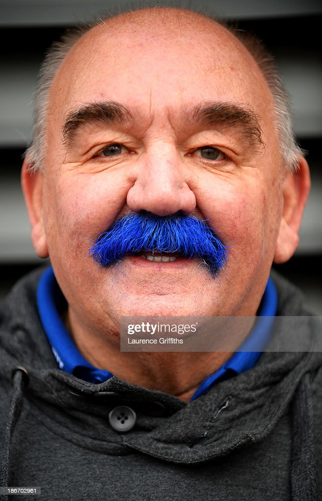 Cardiff City fan shows of his 'blue moustache' prior to the Barclays Premier League match between Cardiff City and Swansea City at Cardiff City...