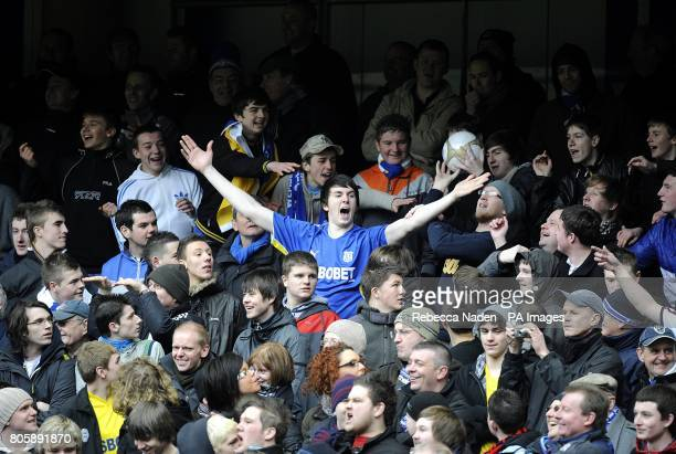 Cardiff City fans taunt Chelsea whilst holding the matchball in the stands