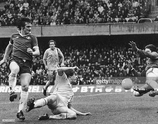 Cardiff City goalkeeper Bill Irwin dives to save a shot from Steve Finnieston of Chelsea during a match at Stamford Bridge London 2nd October 1976